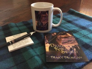 Giveaway: Mug with cover of Dragon Knight's Sword, pen, post-its, and postcard.