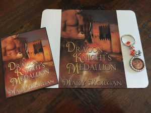 Dragon Knight's Medallion Mousepad, keychain, and postcard.
